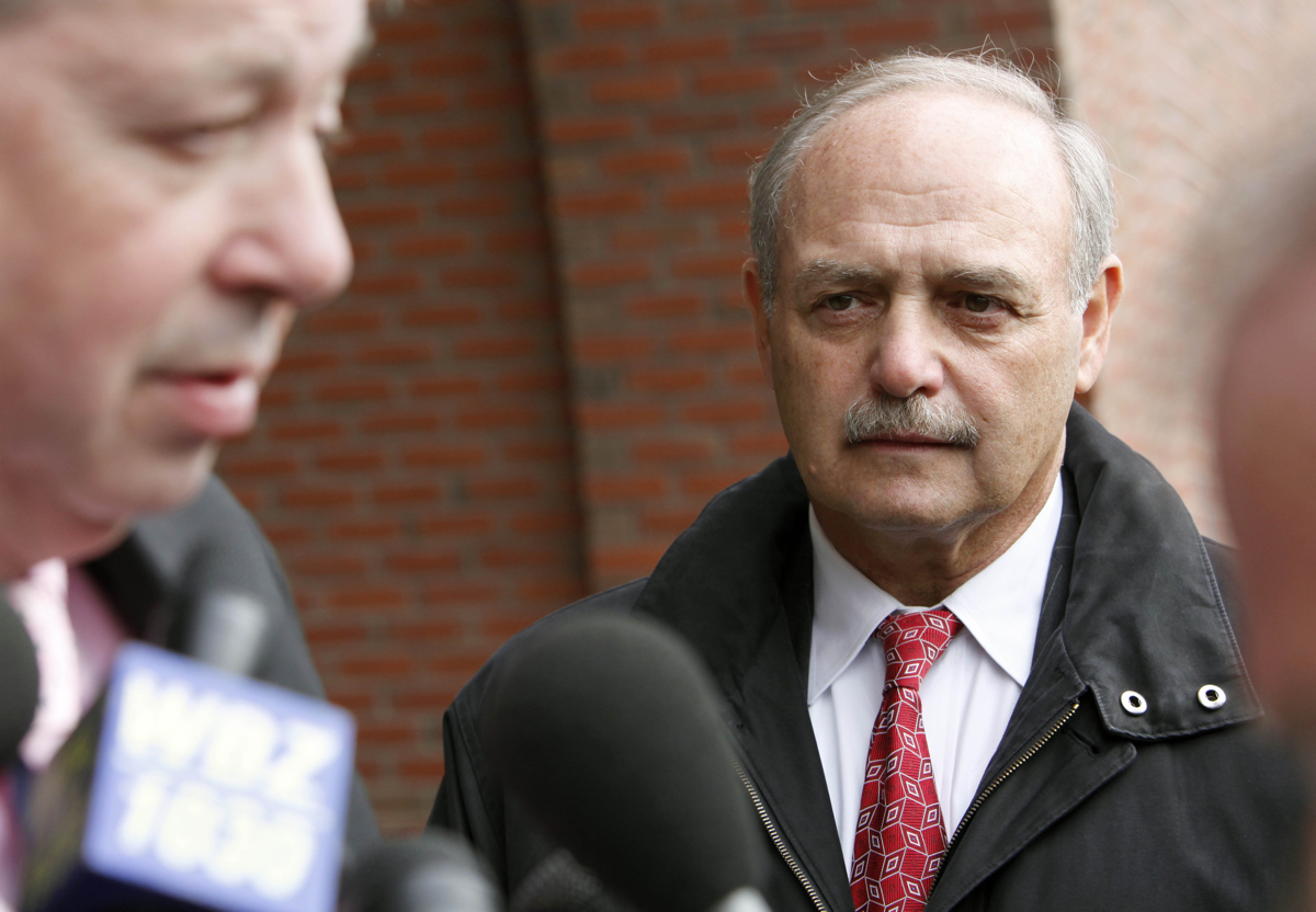 Former Massachusetts House Speaker Sal DiMasi, right, listens to his attorney Thomas Kiley outside federal court where DiMasi pleaded not guilty to federal corruption charges Thursday, Nov. 12, 2009, in Boston. (AP Photo/Michael Dwyer)