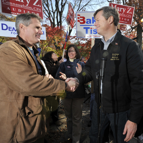 Republican gubernatorial candidate Charles Baker, right, shakes hands with Sen. Scott Brown R-Mass., left, during a campaign event on Saturday, Oct. 30, 2010, on the last weekend before the Nov. 2 Election. (AP Photo/Josh Reynolds)