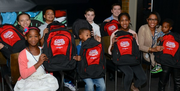 CAMP CHAMPIONS HOLDING UP THEIR BACKPACKS / PHOTO BY ALLEN DINE/NORTHSTAR PHOTOGRAPHY
