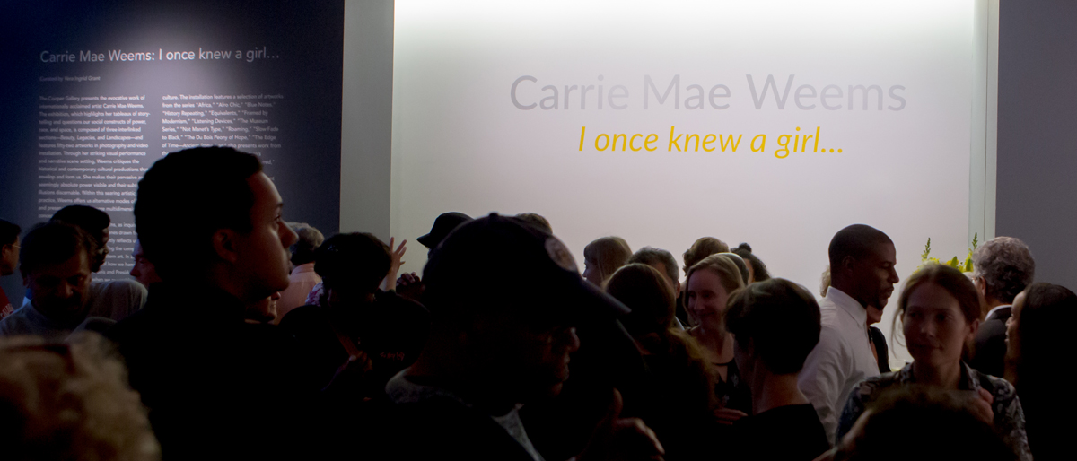 """Public visitors attend opening reception of """"Carrie Mae Weems: I once knew a girl…"""" exhibition running at The Ethelbert Cooper Gallery of African & African American Art in Harvard Square, Cambridge thru January 7, 2017. Photo Credit: Melissa Blackall."""