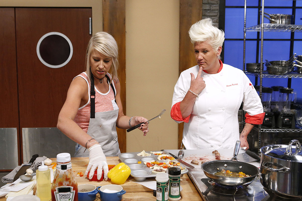 Mentor Anne Burrell checks in on Mandy Thornton as she cooks during the baseline challenge, as seen on Food Network's Worst Cooks in America, Season 10