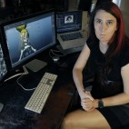 "Brianna Wu, a software engineer and video-game developer, sits at her workstation in Boston on July 25, 2016. She has been a prime target of the online harassment campaign known as Gamergate, which subjected several women in the video-game industry to misogynistic threats. It surfaced in the summer of 2014, and hasn't vanished. ""It's still a constant drumbeat,"" said Wu, who became a target after ridiculing those who'd decried women's advances in the male-dominated industry. (AP Photo/Elise Amendola)"