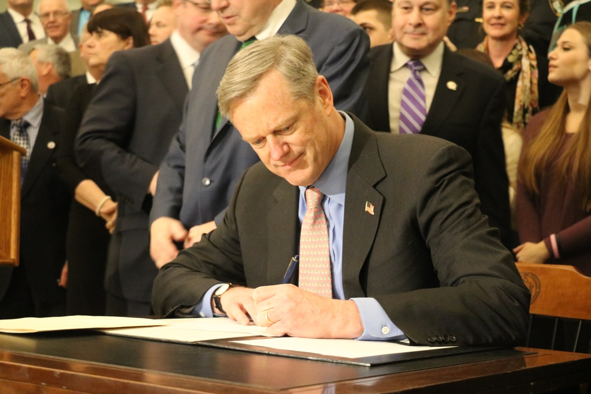 Baker signs opioid legislation in March. Photo via Governor's Office