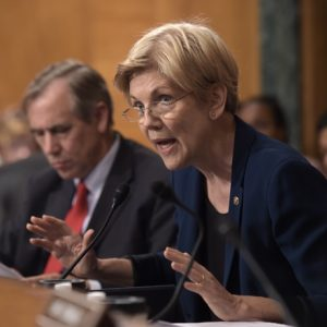 Senate Banking Committee member Sen. Elizabeth Warren, D-Mass., questions Wells Fargo Chief Executive Officer John Stumpf, on Capitol Hill in Washington, Tuesday, Sept. 20, 2016, during the committee's hearing . Stumpf was called before the committee for betraying customers' trust in a scandal over allegations that employees opened millions of unauthorized accounts to meet aggressive sales targets. (AP Photo/Susan Walsh)