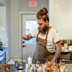 Brandon Baltzley in the kicthen at TMIP , his native food pop-up in Indiana