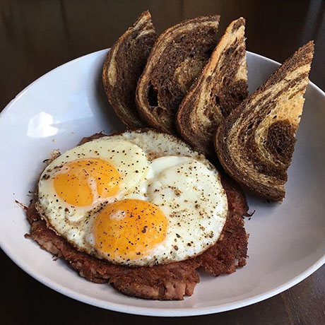 Corned beef hash, sunny eggs, and rye toast from the Gallows' brunch—and Monday brinner—menu