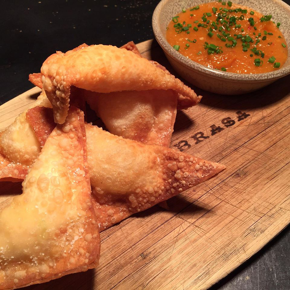 Crunchy lobster rangoon with pear apricot duck sauce at La Brasa