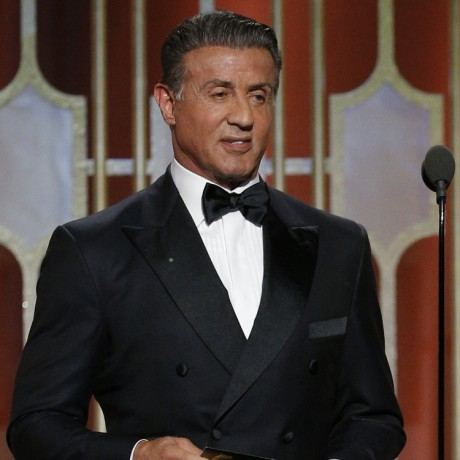 """74th ANNUAL GOLDEN GLOBE AWARDS -- Pictured: (l-r) Sylvester Stallone and Carl Weathers, who co-starred in the 1977 Golden Globe Award-winning film """"Rocky,"""" reunited Sunday at the Beverly Hills Hotel to present the Golden Globe for Best Motion Picture – Drama, at the 74th Annual Golden Globe Awards held at the Beverly Hilton Hotel on January 8, 2017. Weathers will co-star in the new NBC series """"Chicago Justice,"""" which debuts Sunday, March 5 at 9 p.m. -- (Photo by: Paul Drinkwater/NBC)"""