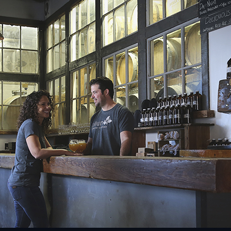 Trillium Brewing Company owners Esther and JC Tetreault inside their current Boston brewery