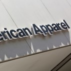 Dusseldorf, Germany - August 20, 2011: American Apparel signage above store entrance. American Apparel is a clothing manufacturer, wholesaler and retailer headquartered in Los Angeles, California, US.