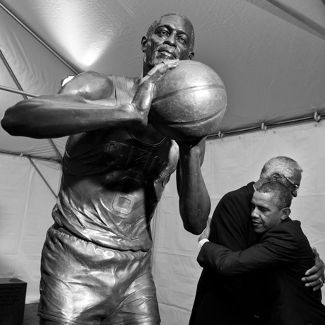 """Oct. 30, 2013 """"The President hugs former Boston Celtics Hall of Fame basketball player Bill Russell during a stop to view the statue of Russell before its unveiling at City Hall Plaza in Boston.""""  (Official White House Photo by Pete Souza)  This official White House photograph is being made available only for publication by news organizations and/or for personal use printing by the subject(s) of the photograph. The photograph may not be manipulated in any way and may not be used in commercial or political materials, advertisements, emails, products, promotions that in any way suggests approval or endorsement of the President, the First Family, or the White House."""