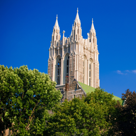 """Gasson Hall located on the campus of Boston College in Chestnut Hill, Massachusetts with trees and a lamppost in the foreground.Other images of Boston College:"""