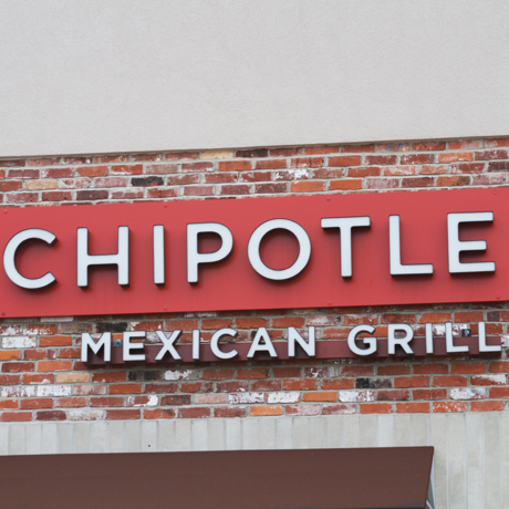Fairfield, Ohio, USA - February 25, 2011 : Chipotle Mexican Grill Logo on brick building. Chipotle is a chain of fast casual restaurants in the United States and Canada that specialize in burritos and tacos.