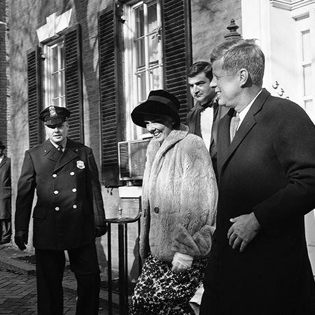 President-elect John F. Kennedy is accompanied by Dr. Janet Travell of New York and his press secretary, Pierre Salinger, as he leaves his Washington residence, Nov. 26, 1960 to visit his wife and their new son in Georgetown University Hospital. Dr. Travell is a back specialist who has treated Kennedy in the past. (AP Photo)