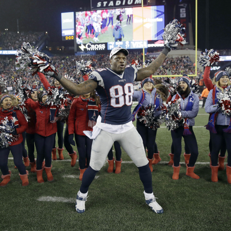 New England Patriots tight end Martellus Bennett celebrates with cheerleaders after the AFC championship NFL football game against the Pittsburgh Steelers, Sunday, Jan. 22, 2017, in Foxborough, Mass. The Patriots defeated the the Steelers 36-17 to advance to the Super Bowl. (AP Photo/Charles Krupa)