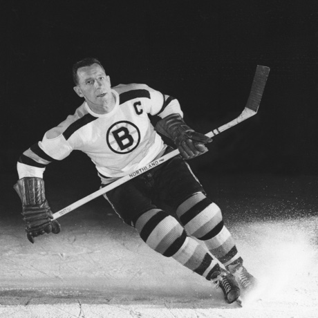 Milt Schmidt, captain of the Boston Bruins, is shown in an action pose in Sept. 1953.  (AP Photo)