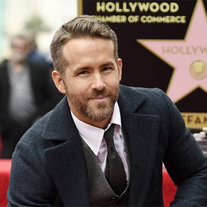 """FILE - In this Dec. 15, 2016 file photo, actor Ryan Reynolds poses at a ceremony honoring him with a star on the Hollywood Walk of Fame in Los Angeles. Reynolds has been named Man of the Year by Harvard University's Hasty Pudding student theatrical group.  The actor who played the title role in 2016's """"Deadpool"""" will be roasted by the student group before being getting his pudding pot on Feb. 3. (Photo by Chris Pizzello/Invision/AP, File)"""