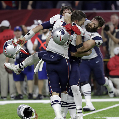 New England Patriots' Tom Brady, foreground, celebrates with his teammates after winning the NFL Super Bowl 51 football game against the Atlanta Falcons in overtime Sunday, Feb. 5, 2017, in Houston. The Patriots won 34-28. (AP Photo/Eric Gay)