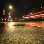 Wet asphalt tail lights motion blur - low-angle view