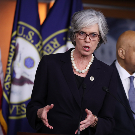 Rep. Katherine Clark, D-Mass., left, accompanied by Rep. Elijah Cummings, D-Md., right, speaks during a news conference on Capitol Hill in Washington, Thursday, Jan. 12, 2017, to discuss President-elect Donald Trump's conflicts of interest and ethical issues. (AP Photo/Manuel Balce Ceneta)