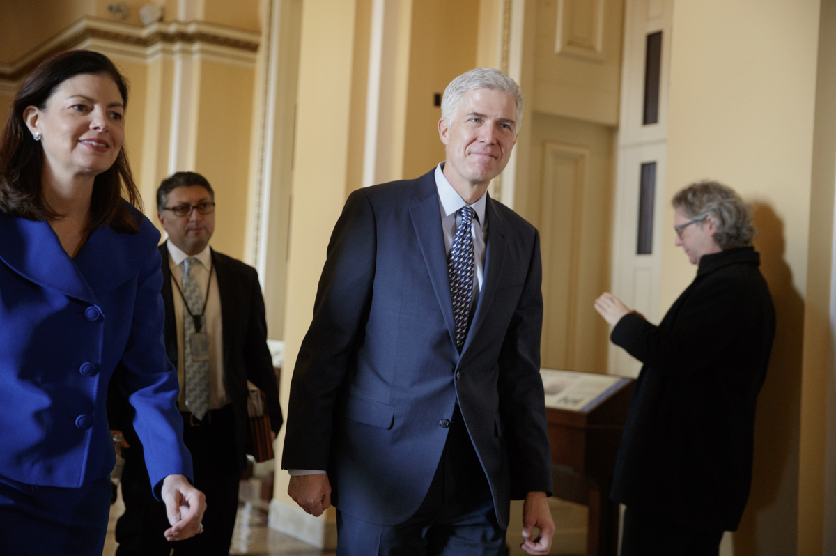 Supreme Court Justice nominee Neil Gorsuch, right, is escorted by former New Hampshire Sen. Kelly Ayotte on the way to a meeting with Sen. Ted Cruz, R-Texas, a member of the Senate Judiciary Committee, Thursday, Feb. 2, 2017, on Capitol Hill in Washington. (AP Photo/J. Scott Applewhite)