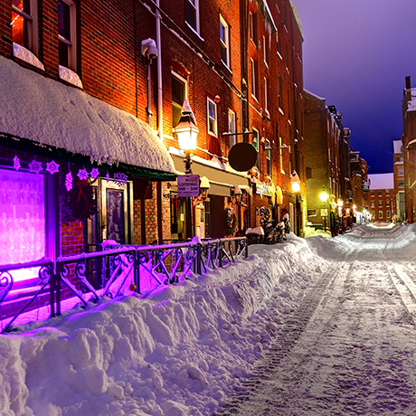 Snow covered narrow city street in Historic Portland, Maine
