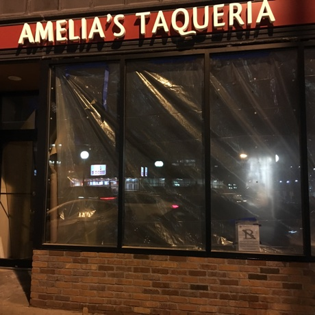 Signs are up for AMelia's Taqueria in Cleveland Circle