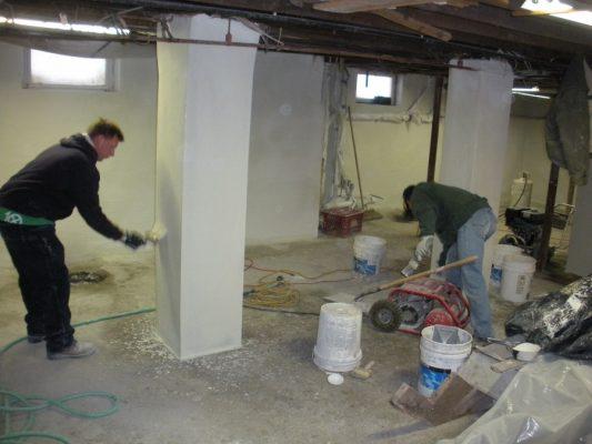 Applying the final coat of waterproofing