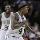Boston Celtics guard Isaiah Thomas (4) celebrates after scoring during the fourth quarter of an NBA basketball game against the Miami Heat as Celtics forward Jae Crowder, left, joins in, Sunday, March 26, 2017, in Boston. The Celtics won 112-108. (AP Photo/Steven Senne)