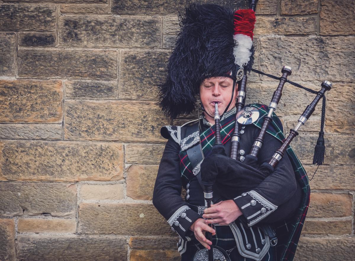 Edinburgh, Scotland - 02 September 2016 : Man playing traditional pipes on the streets of Edinburgh