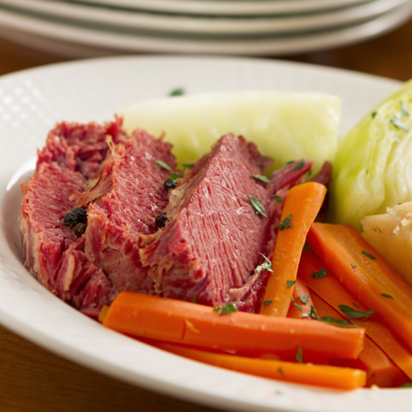A classic boiled dinner of corned beef, cabbage, potatoes, onions, and carrots.