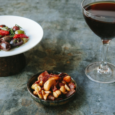 Marinated olives & pepper, bacon roasted nuts and a Manhattan at Freepoint Kicthen and Cocktails
