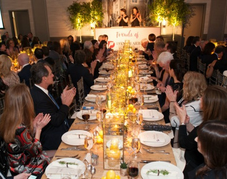 Guests enjoy hearing from Friends CoPresidents, Suzanne Chapman and Jen Cunningham Butler, as well as a beautiful scene set by Tyger Productions / Photo by Melissa Ostrow