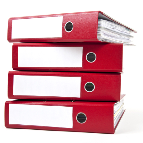 red ring binders against a white background