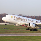 Dusseldorf, Germany - December 17, 2015: Emirates Airbus A380 take off from Dusseldorf airport. Soccer players of Real Madrid are painted on the airplane to show the partnership between Emirates and Real Madrid.