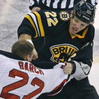 Boston Bruins right wing Shawn Thornton, right, lands a punch during a fight with New Jersey Devils right wing Krys Barch (22) during the first period of an NHL hockey game in Boston, Tuesday, Jan. 29, 2013. (AP Photo/Charles Krupa)