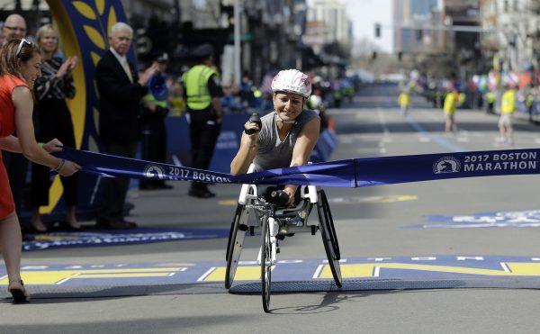 Manuela Schar, of Switzerland, wins the women's wheelchair division in the 121st Boston Marathon on Monday, April 17, 2017, in Boston. (AP Photo/Elise Amendola)