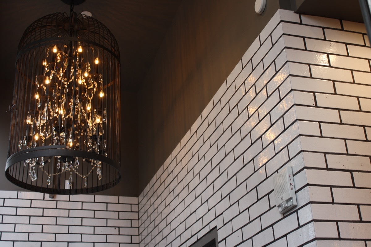 The latest Blackbird Doughnuts has the same cage chandelier as the original location in the South End. / Photos by Jacqueline Cain
