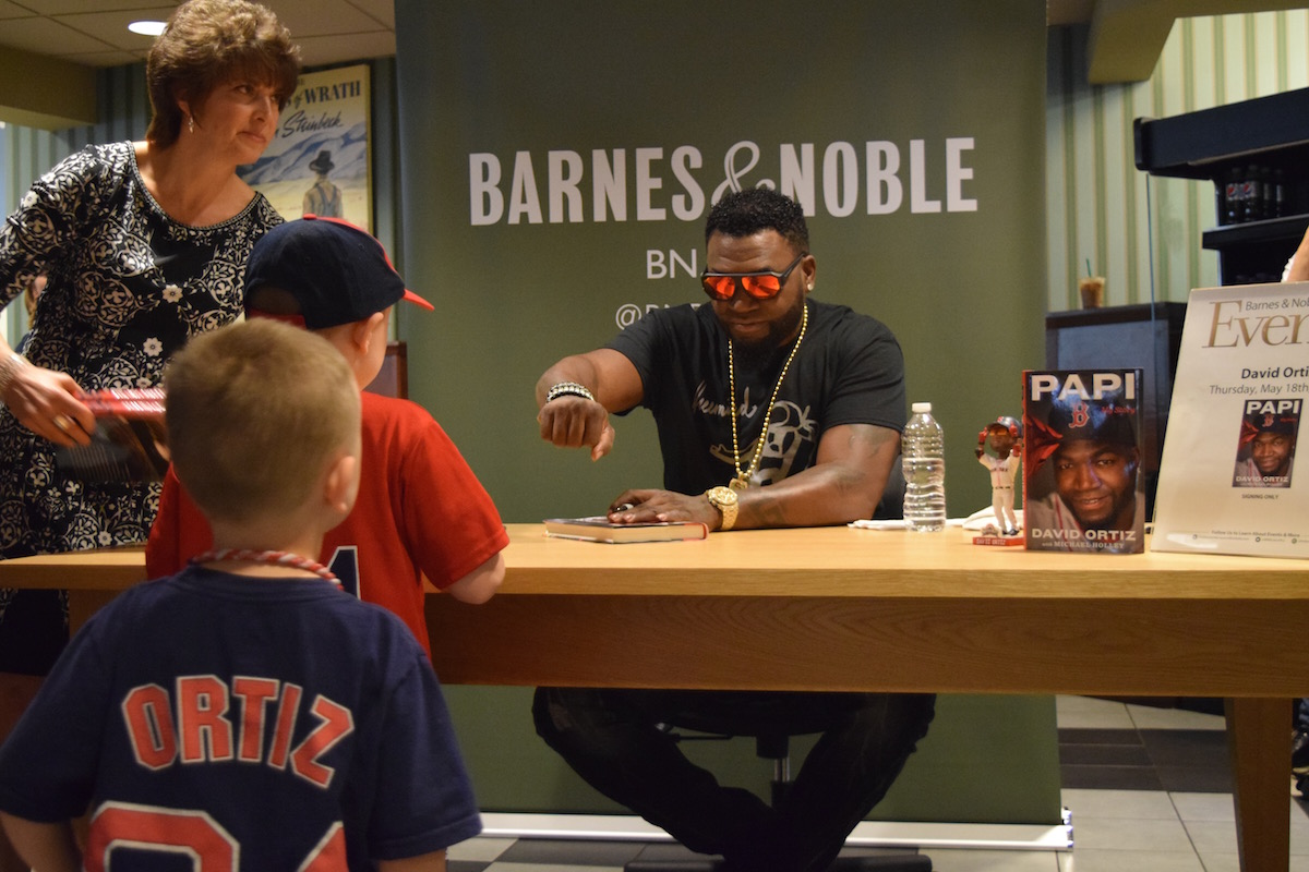 David Ortiz fist bumps a young fan