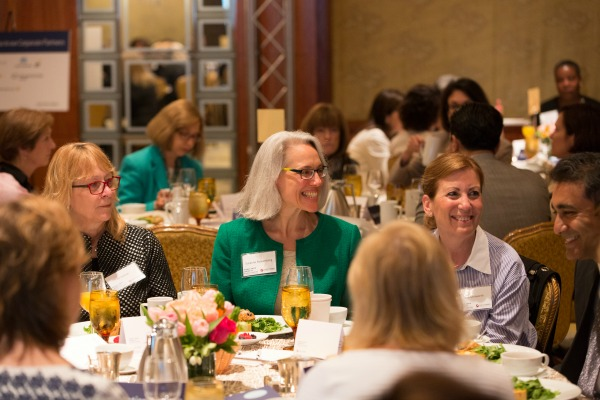 Breakfast attendees Jill Hatton, Suzanne Reasenberg, Lisa Unsworth, and Dana-Farber physician-researcher Dipanjan Chowdhury, PhD / Photo by Michael Blanchard