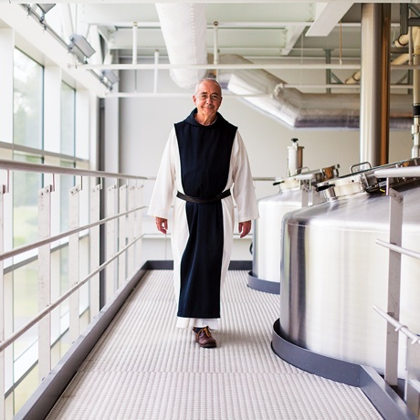 Father Isaac Keeley inside the state-of-the-art brewhouse at Spencer Brewery