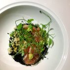 Shuai Wang of Short Grain made Salmon Tataki with Black Garlic Vinaigrette, Preserved Lemon, and Puffed Rice for a collaboration dinner with Mei Mei and others at the James Beard House