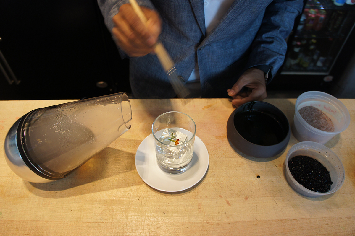 Tenzin Samdo creates a cocktail with Le Whaf at Café ArtScience