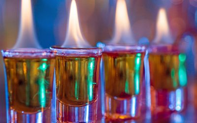 Burning cocktails in shot glass served on the bar