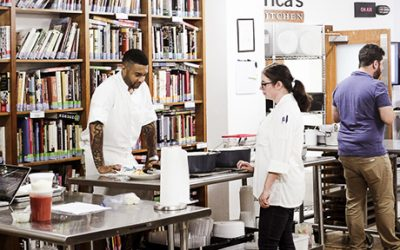 Employees meet and test recipes in the library at America's Test Kitchen in Brookline Village