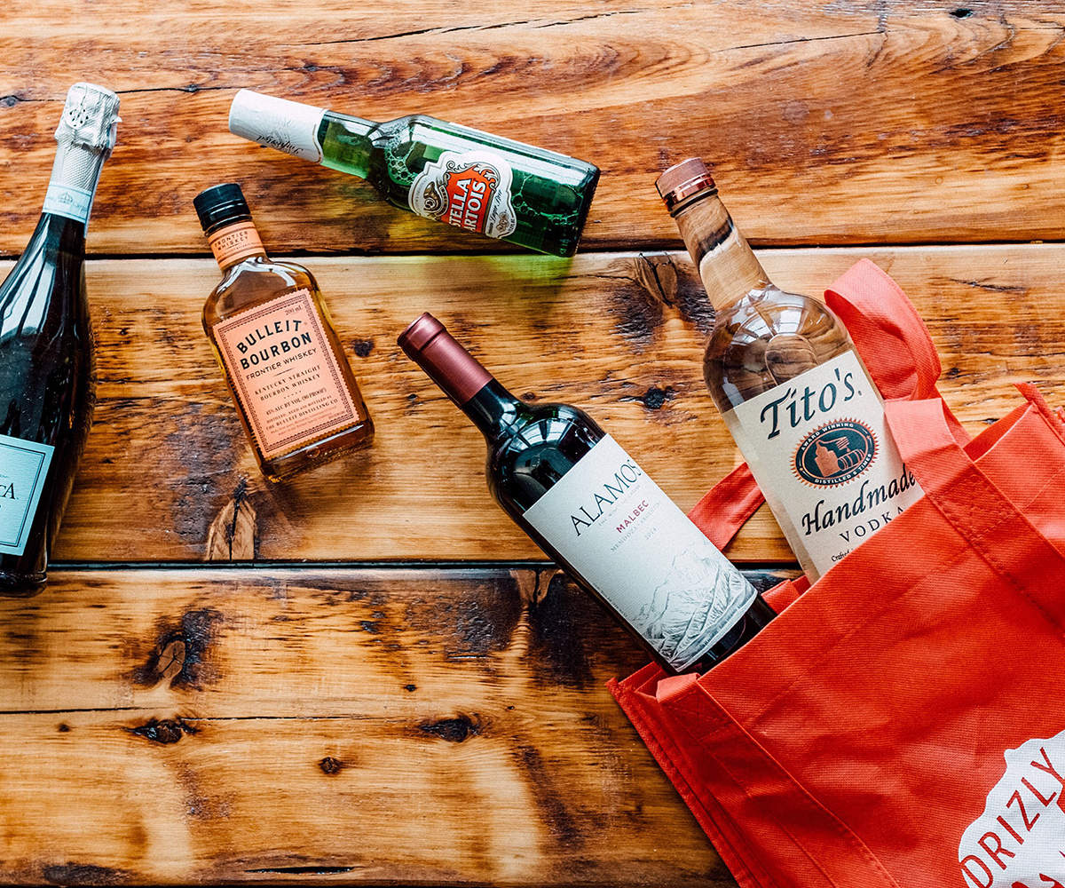 Bottles of alcohol splayed out on a table