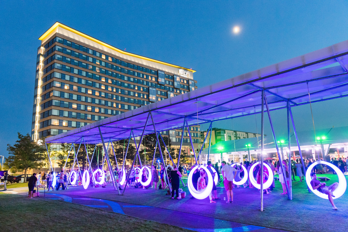 Circular swings on the Lawn on D lit up at night
