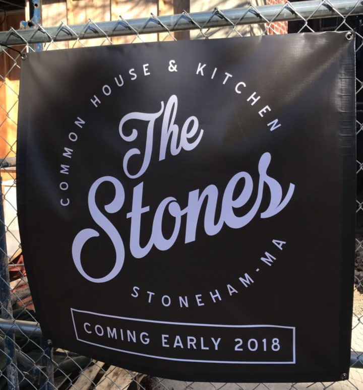 Temporary signage is up at the Stones Common House in Stoneham