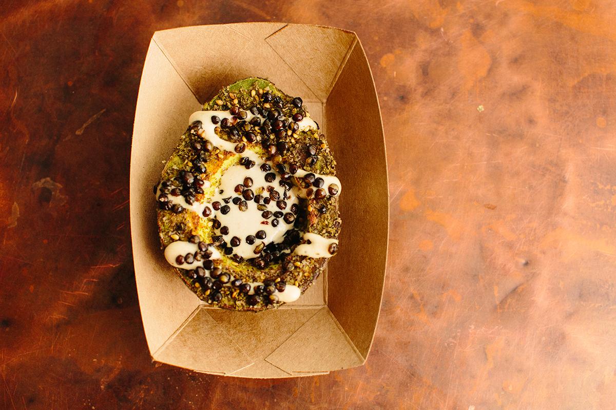 The seared avocado with tahini, za'atar, and crispy lentils at Whole Heart Provisions