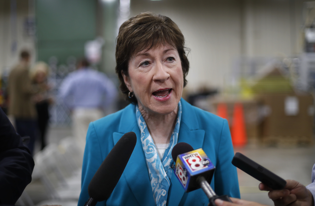 """U.S. Sen. Susan Collins, R-Maine, attending an event in Lewiston, Maine, Thursday, Aug. 17, 2017, speaks to reporters about President Donald Trump's recent comments about the violence in Charlottesville, Va. Collins criticized Trump for failing to speak forcefully against racism, bigotry and anti-Semitism """"from the very beginning,"""" and said she doesn't understand why he backtracked on a forceful statement against racism earlier in the week. (AP Photo/Robert F. Bukaty)"""
